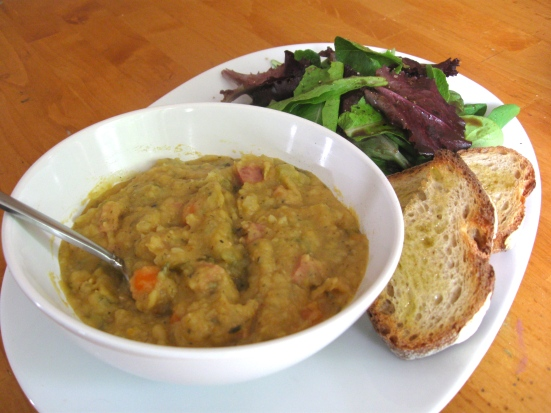 Bowl of Yellow Pea Soup with Salad and Crusty Bread