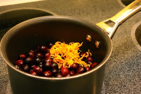 Cranberries in a sauce pan with orange zest