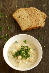 bowl of chowder with brown bread slices