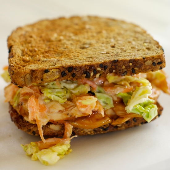 Toasted sandwich with coleslaw and bbq chicken