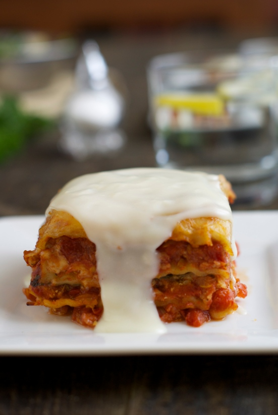 piece of lasagna with white sauce