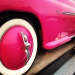 Vintage Pink Car with Nude Woman Wheel Cover