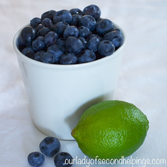 Cup of blueberries and a lime