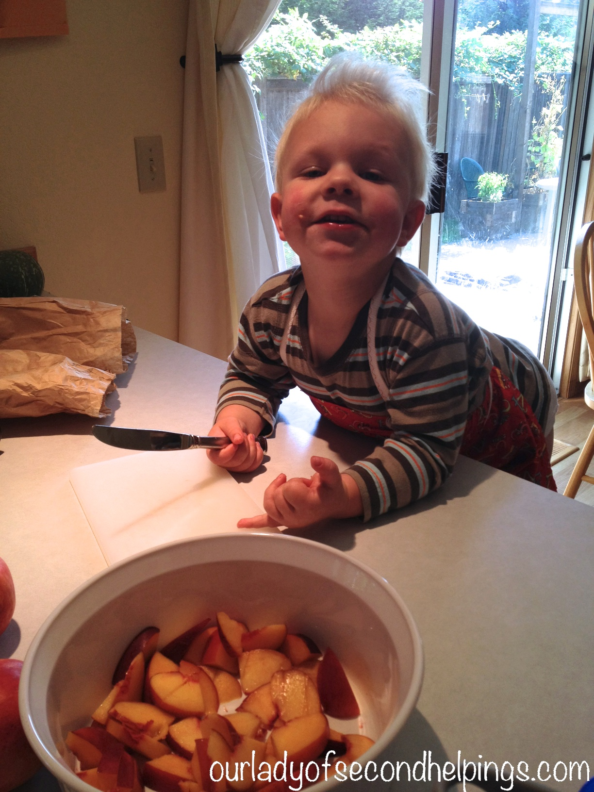 Child Helping to Cut Fruit