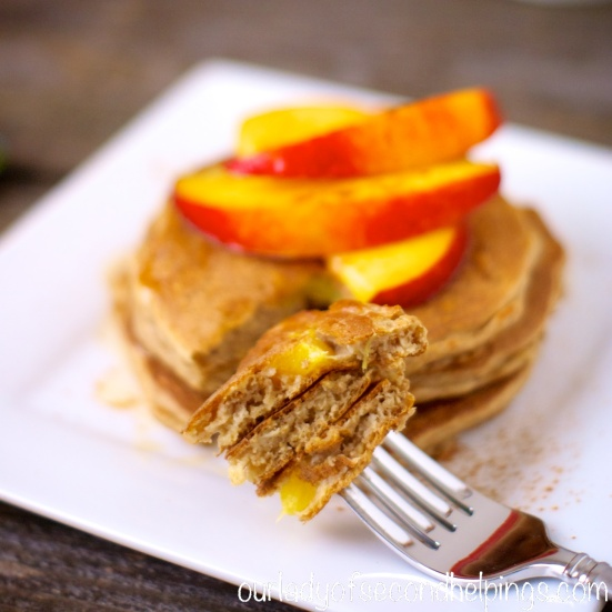 Plate of pancakes with nectarine slices