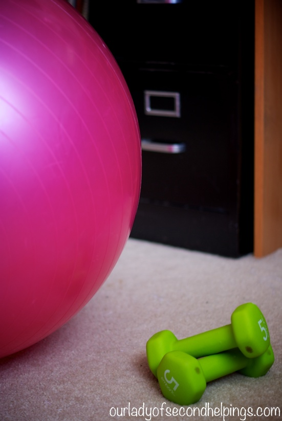 hand weights and Pilates ball