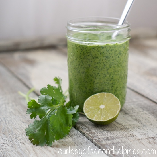 Jar of homemade pesto with cilantro and lime